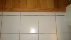 repairing the grout in the master bath