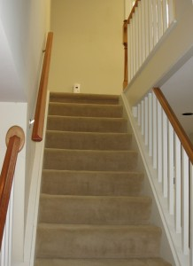 stairs with old wall to wall carpet