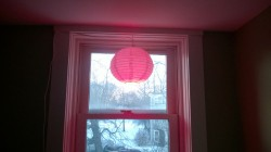 chinese lantern hanging in upstairs hall window