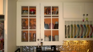 painting the glass front kitchen cabinet benjamin moore calypso orange