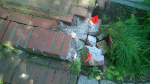 original old brick front stoop crumbling