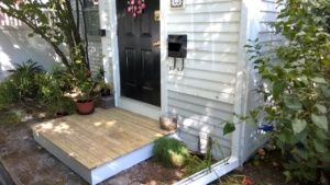 new wooden front stoop which replaced the crumbling brick one