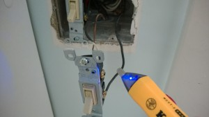 testing for voltage while replacing the bathroom light switch with a timer
