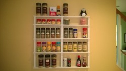 DIY spice rack on kitchen wall