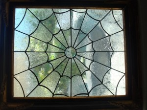stained glass spider web window