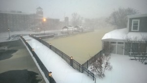 ipswich river covered in ice and riverwalk bridge covered in snow