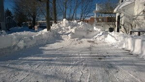 our driveway after being plowed by a large truck