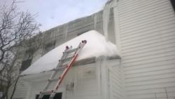 shoveling the front entranceway roof during snowmageddon 2015