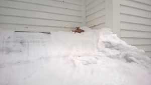 putting diy ice dam roof ice melters on the roof during snowmageddon 2015
