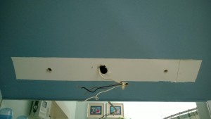 removing the old vanity light bar in the master bathroom