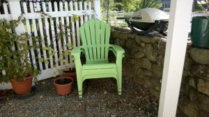 corner of yard with green plastic adirondack chairs
