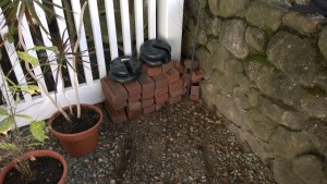 corner of yard with bricks and weights