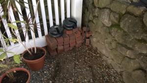 corner of yard with bricks and weights