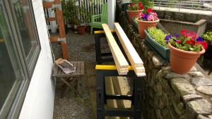 outdoor cat enclosure / catio cutting the shelf slats in the yard