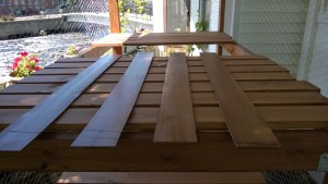 staining luan slats for the outdoor cat enclosure / catio to cover the staples