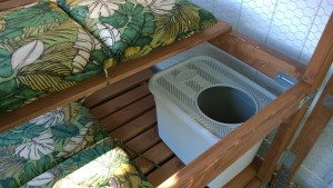 litter box installed in the outdoor cat enclosure / catio