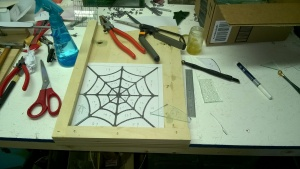cutting glass with abbie for my stained glass spiderweb
