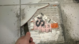fixing the cracked tile in the master bathroom