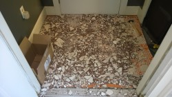 removing the tiles from the front hall entranceway