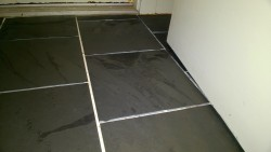 slate tiles laid in the front hall