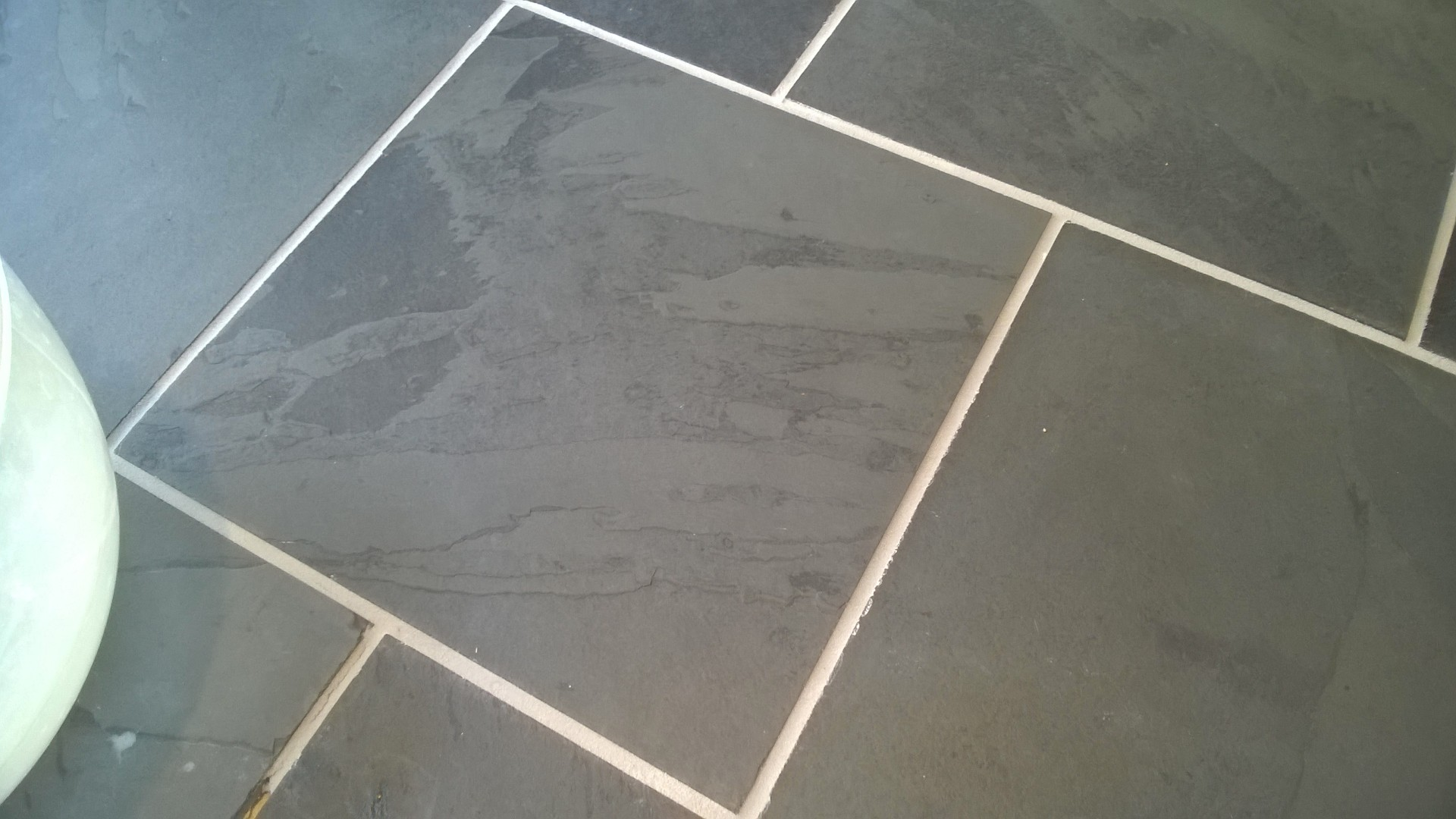 Best way to remove grout from floor tiles
