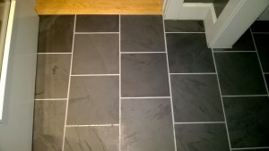grouting the slate tiles in the front entrance hall and closet