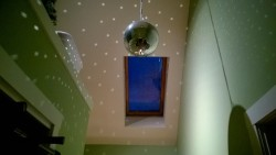disco ball and reflections / sparkles / polka dots in the upstairs hallway