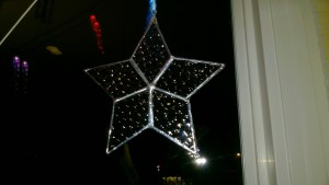 bubble glass stained glass star hanging in living room window