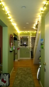 hanging string lights and metallic foil stars in the downstairs hallway