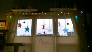 stained glass stars, disco balls, and daniela's angel in the living room window