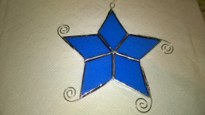 blue stained glass snowflake star