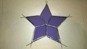 purple stained glass snowflake star