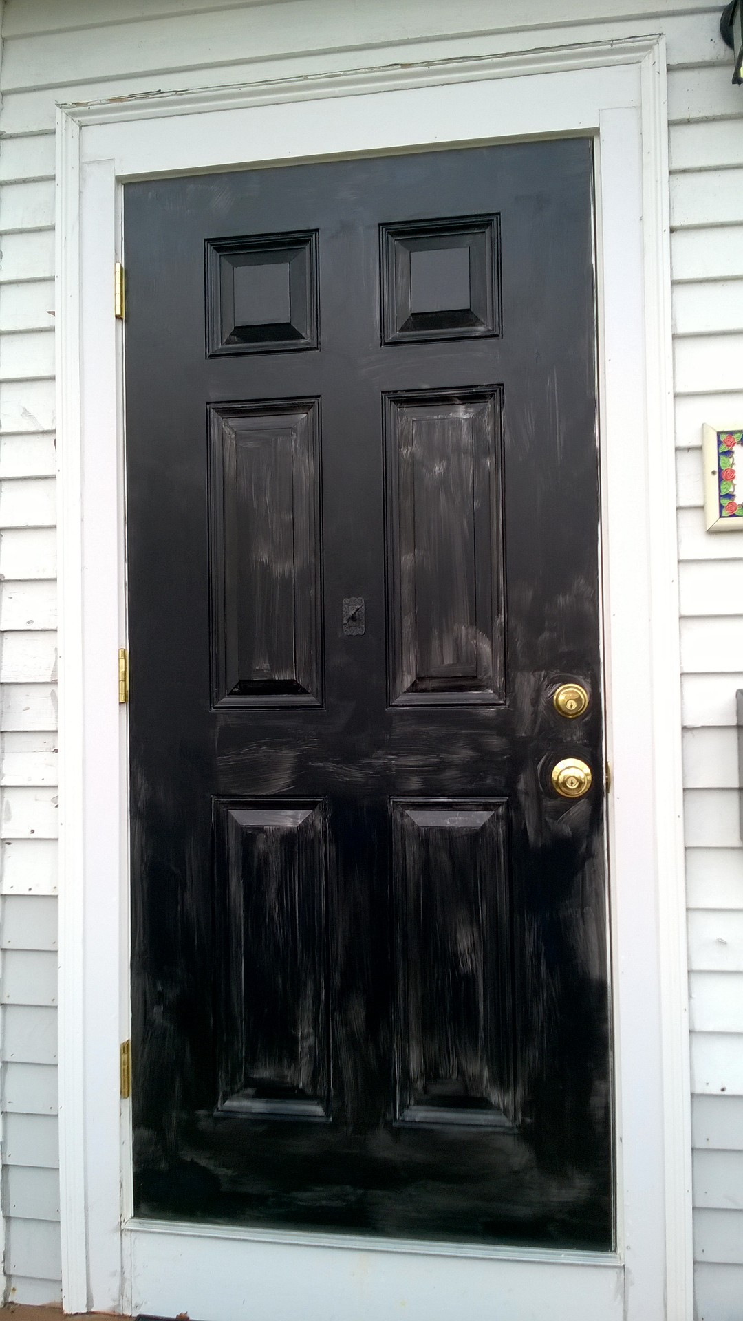 I painted our new front door black orbited by nine dark moons its thick like chocolate pudding and dark purple but it goes on smoothly and dries to a shiny black this is my first experience with exterior paint and rubansaba