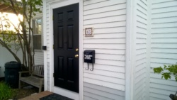 our front door after 3 coats of black semi-gloss behr paint