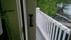 closeup of handle on inside of screen door