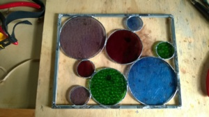 all the stained glass circles are now soldered into the metal frame