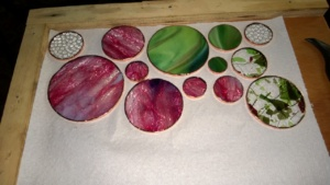 my second batch of stained glass circles with the edges copper foiled