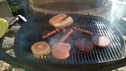 grilling 3 veggie dogs, 2 veggie burgers, & rolls