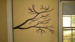 cherry blossom branch i painted on abbie's twins' bedroom wall
