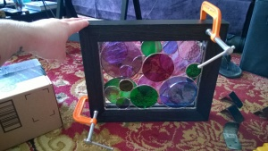 clamping the 2 frames of my first stained glass circles project together