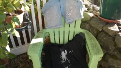 i spilled silver leaf paint all over my shirt, shorts, and canvas board panel