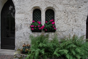 beautiful windows and flower boxes in the courtyard leading to castle lichtenstein