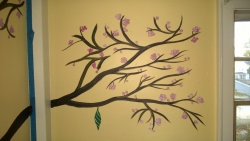 i painted butterfly chrysalis hanging from the cherry blossom tree on abbie's wall