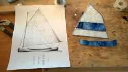 i soldered 3 pieces of glass together to make the catboat sail and one piece for the base