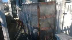 winterizing the catio by stapling clear plastic tarp to the front & sides
