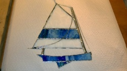 i added thin metal wire rigging to the stained glass sailboat