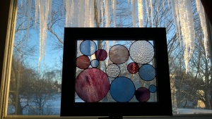 stained glass circles frame in front of icicles