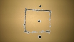 i screwed the drywall patch into the shim i'd placed inside the wall