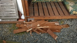 the pile of old luan slats I pulled off the catio