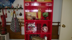 the tall red bookcase in the girl cave is all put back together